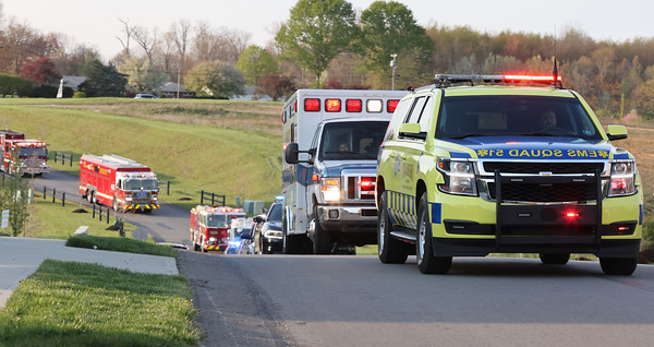 Emergency response vehicles parade by the home of Ford Bartle, 4, for his birthday Tuesday. Seb Foltz/Butler Eagle  04/20/21
