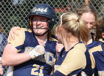 Knoch's Bailey Rickenbrode (21) celebrates with teammates following her grandslam against Freeport. The homer gave Knoch the lead. The Knights held on to win 6-5. Seb Foltz/Butler Eagle 04/20/21