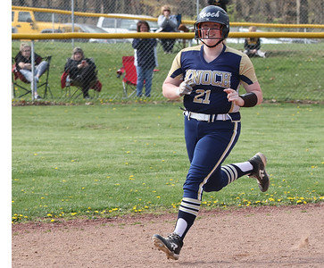 Knoch's Bailey Rickenbrode (21) rounds the bases following her grandslam. The homer gave Knoch the lead. The Knights held on to win 6-5. Seb Foltz/Butler Eagle 04/20/21