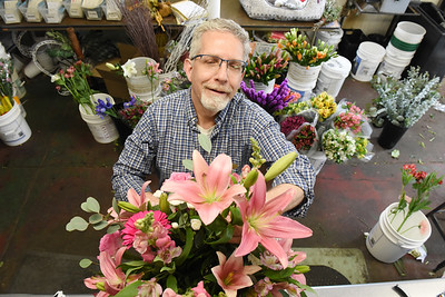 Ed Bloom of the Bortmas, The Butler Florist puts together an arrangement of flowers for a customer. Harold Aughton/Butler Eagle.