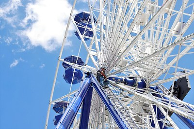 Ferris wheel technician Brian Cotham tests lighting systems in preparation for the Big Butler Fair set to get underway later this week. Seb Foltz/ Butler Eagle