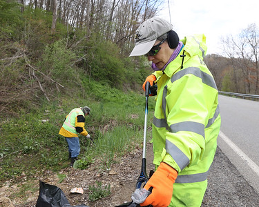Valerie Alexander,67, collects litter with her husband Rick, 70, along Litman Road near the intersection with Route 8. Seb Foltz/Butler Eagle 04/22/21
