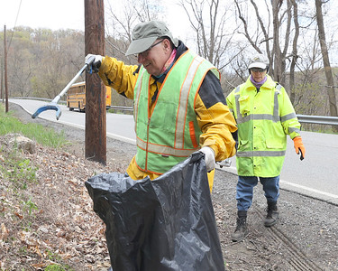 Rick Alexander, 70, collects litter with his wife Valerie, 67, along Litman Road near the intersection with Route 8. Seb Foltz/Butler Eagle 04/22/21