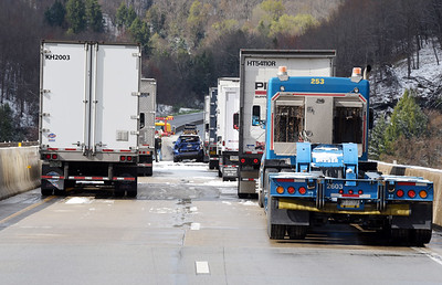 A tow truck driver prepares to remove a wreck vehicle on the I-80 Bridge near Emlenton. The wreck occurred around 6:00 a.m., shutting down East-bound traffic Thursday, April 22, 2021. Harold Aughton/Butler Eagle.