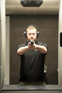 Tucker Nuetzel, salesman, for the Keystone Shooting Center, takes aim at the indoor shooting range. Harold Aughton/Butler Eagle.
