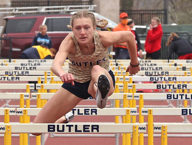 Butler's Emma Lehman competes in the 100 meter hurdles in Saturday's Butler Invitational. Lehman finished second in the event. Seb Foltz/Butler Eagle 04/25/21