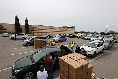 Cars lineup for Saturday's food distribution put on by Network of Hope at Clearview Mall. Seb Foltz/Butler Eagle 04/24/21