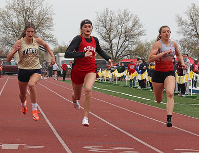 Mohawk's Hannah McDanel (center) edges out Butler's Alli Morrow and Slippery Rock's Anna Kadlubek for a first place finish in the 100 meter. Morrow finished  third and Kadlubek fourth. Seb Foltz/Butler Eagle