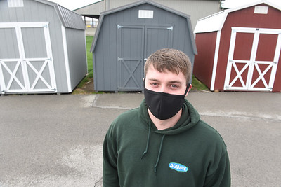 Cody Stephenson, manager of Agway, stands amid display of outdoor sheds. Harold Aughton/Butler Eagle.