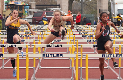 Butler's Emma Lehman (center) competes in the 100 meter hurdles in Saturday's Butler Invitational. Lehman finished second in the event. Seb Foltz/Butler Eagle 04/25/21