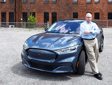 Nick Ban of Butler County Ford with the new Mustang Mach-E. Harold Aughton/Butler Eagle.