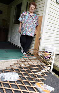 Nancy Roach of Middlesex Twp.stands in front of her broken porch fence that she believed was damaged by a black bear. Harold Aughton/Butler Eagle.