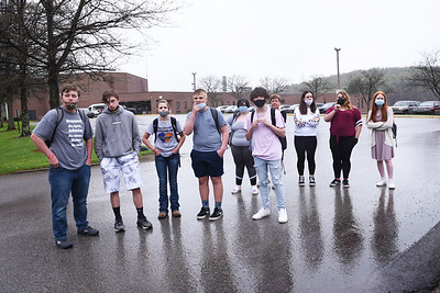 On cold and wet Thursday, April 29, 2021, at least 10 students walked out of Karns City High School as part of a protest against disciplinary action against a senior for his alleged role in a fight at Butler Vo-Tech. From right to left: Zach Scherer, Zane Everetts, freshman, Zoe Everetts,, Cayden Vodenichar, Ansley Hindman,  Hayden Miller, Abrianna Glosser, Angel Eppinger, and Adalyn Jones. Also present beside Ansley Hindman towards the back of the photo is her mother, Erin Hindman.   Photo by Lauryn Halahurich/Butler Eagle