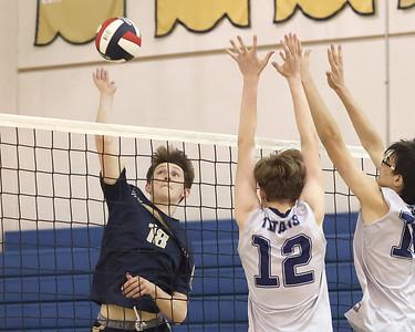 Butler's Cade Wheeler spikes a ball past Shaler's Logan Peterson (12) and Luke Hoffman (10). Seb Foltz/Butler Eagle 04/29/21