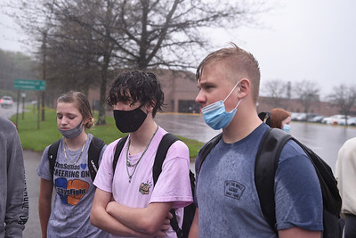 From right to left: Zoe Evertts, Hayden Miller, and Cayden Vodenichar joined about 7 other students in a walk out at Karns City High School on April 28. 2021. The walk out is part of a protest by students that belive the the expulsion of a student involved in an alleged fight at Butler Vo-Tech earlier in May is excessive. The walk out occured a little bit after during a rainstorm.  Photo by Lauryn Halahurich/Butler Eagle
