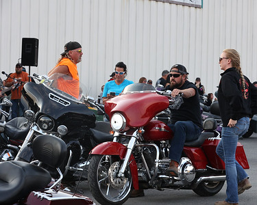 Bikers gather for Wednesday's Blessing of the Bikes. Dozens of motorcycle riders took part in the celebration at the Crossbow Lounge at Sherwood Lanes in Lyndora Wednesday. Seb Foltz/Butler Eagle 04/07/21