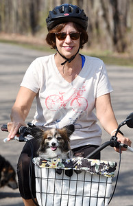 Retirees Barb and Dave Wagner of Butler took their, 7-year-old Papillion, Lucy, for a bike ride through Alameda Park Wednesday morning. April 7, 2021. Harold Aughton/Butler Eagle.