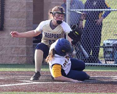Mars pinch runner Steph Esswein slides home for the game tying run, beating the tag from Freeport pitcher Sydney Selker. Mars won at home 9-8. Seb Foltz/Butler Eagle 04/07/21