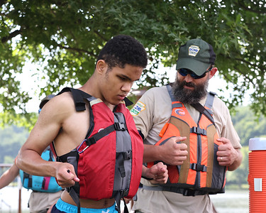 Brian Gula, (back) with the Department of Conservation and Natural Recources helps Envision Blind Sports camper James Trimble, 16, with his life jacket Friday, prior to a kayaking session at Moraine State Park. Seb Foltz/Butler Eagle 07/30/21