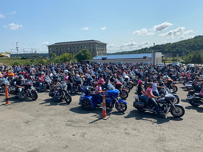 Participants in the 10th annual Riding For The Cure motorcycle ride ready for its start Saturday morning in the parking lot at Sherwood Lanes in Lyndora. ERIC FREEHLING/BUTLER EAGLE