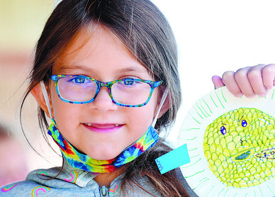 Abby Harley, 9, of Cranberry Twp. shows off her art project that she made during Camp Cranberry Tuesday morning. Harold Aughton/Butler Eagle