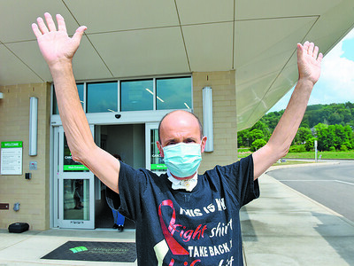 Scott Hainley of Prospect celebrates his last treatment as he leaves the Allegheny Health Network Cancer Institute in Butler Wednesday afternoon. Harold Aughton/Butler Eagle