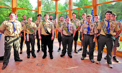Caption: Eagle Scouts from the Moraine Trails Council division of the Boy Scouts of America pose for a picture prior to a dinner in their honor at Camp Bucoco Wednesday Aug. 4 2021. Seb Foltz/Butler Eagle