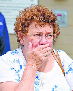 Donna Hainley sheds a tear after watching her son, Scott Hainley, walk out of the Allegheny Health Network Cancer Institute, after receiving his last treatment Wednesday afternoon. Harold Aughton/Butler Eagle