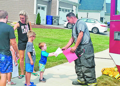 """BUFFALO TWP — Multiple fire crews fought to extinguish a house fire at 196 Creekside Road in the township Friday afternoon after a neighbor noticed smoke coming from the property. Chelsey Ripple was getting her children ready for the pool around 1:45 p.m. when she smelled smoke.As the fire crews were wrapping up the scene, a group of children approached the firefighters to give them colorful """"thank you"""" drawings. Friday, Aug. 6, 2021   Eddie Trizzino/butler eagle"""