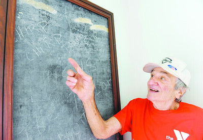 Jack Povlick, 83, of Butler Twp. stands in front of the original blackboard at the Eberhart School No. 6 building in which he owns along Whitestown Road.  Harold Aughton/Butler Eagle