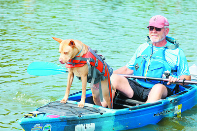 John George and his dog Logan get ready to paddle in Saturday's kayak race at the Moraine State Park Regatta. Seb Foltz/Butler Eagle 08/07/21