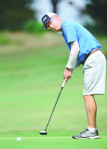Jeremy Plaisted attempts a putt during the Butler Eagle Amateur Sunday afternoon.  Harold Aughton/Butler Eagle.