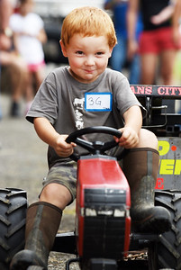 Trace Waltemyer, 3, the grandson of the late Farm Show director Randy Kummer, took 2nd place in the Kiddie Tractor Pull at the Butler Farm Show Tuesday afternoon. Trace attended the event with his mother Jessi Waltemyer. Harold Aughton/Butler Eagle