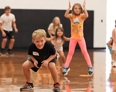 Second grader Joseph Hauser joins in with Butler Catholic kindergarteners for exercises at the school's kindergarten kickoff Wednesday. Seb Foltz/Butler Eagle 08/11/21