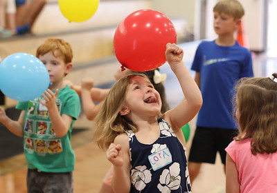 Cora Leyland and other Butler Catholic kindergarteners hit a balloons at one of the activity stations at the school's kindergarten kickoff celebration Wednesday. Seb Foltz/Butler Eagle 08/11/21