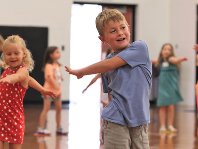 Matthew Hauser and other Butler Catholic kindergarteners follow excercise instructions at the schools Kindergarten kickoff celebration Wednesday. Seb Foltz/Butler Eagle 08/11/21
