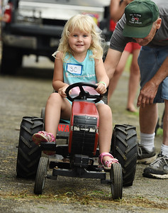 Cassandra Collins, 3, of Butler competed in the Kiddie Tractor Pull at the Butler Farm Show Tuesday afternoon. Harold Aughton/Butler Eagle