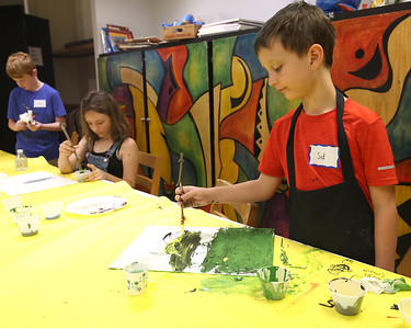 Sid Eismann, 9, works on a project at Butler Art Center's Art & Nature Camp Thursday. Campers made paint brushes out of sticks and natural materials like feathers and pine branches in order to do their paintings. The center's week-long camp program focuses on making projects using natural materials. Seb Foltz/Butler Eagle 08/12/21