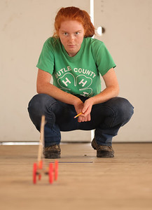 Gretchen Kellar, 16, watches her mouse trap race car roll to a stop in the Butler 4H Club's robotics competition Wednesday at the Butler Farm Show. Seb Foltz/Butle Eagle 08/11/21
