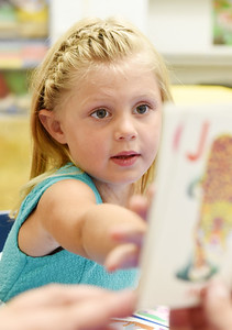 Lizzie Jordan, 4, identifies letters during a pre-school class at Butler Catholic. Harold Aughton/Butler Eagle.