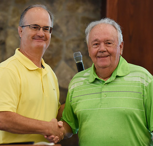 Keith Frndak, president/ceo of Concordia Lutheran Ministries, left, congratulates resident Bud Sears for winning the Horst and Elanor Schwalm Faith and Caring Award for his volunteer work during the pandemic. Harold Aughton/Butler Eagle