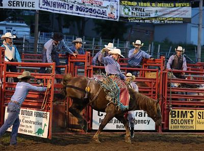 Jamie Griswold competes in the bronc riding at the Washington Rodeo Tuesday night. Seb Foltz/Butler Eagle 08/17/21
