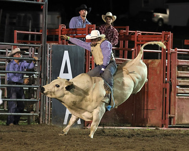 Jackson Smith hangs on in Tuesday night's bull riding competition at the North Washington Rodeo. The annual event runs through Saturday, Aug. 21. Seb Foltz/Butler Eagle 08/17/21
