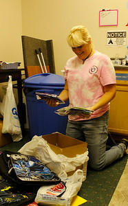 Pammie 2: Pammie Erskine, owner of Mars Candy Land, puts donated supplies into backpacks to give away to kids in need. Julia Maruca/Butler Eagle
