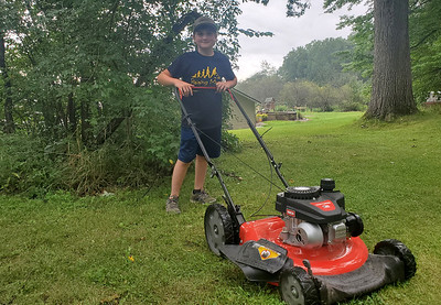 As a reward for completing the 50 yard challenge, Hunter Smith received a brand new lawnmower and a T-shirt, pictured here.EDDIE TRIZZINO/BUTLER EAGLE
