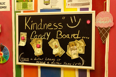 """Kindness board: The backpack giveaway grew out of Mars Candy Land's """"Kindness Board"""" project, a board where customers can leave an extra dollar for kids or other customers who might be short on cash.  Julia Maruca/Butler Eagle"""