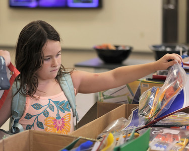 Kendall Schlafhauser, 7, gets geared up for the school year at the Butler YMCA's shool supply drive Thursday. Seb Foltz/Butler Eagle 08/18/21