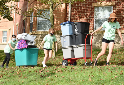 Student volunteers, from left, Natalia Siles, Aimee Campbell, and Tianna Bowser help their fellow students move in to their dorms at Slippery Rock University Thursday morning. Harodl Aughton/Butler Eagle.