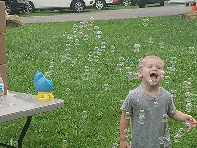 Bubbles: Charlie Edwards, 5, of Butler Township, plays with a bubble machine at a Marci Mustello event at Memorial Park Thursday.EDDIE TRIZZINO/BUTLER EAGLE