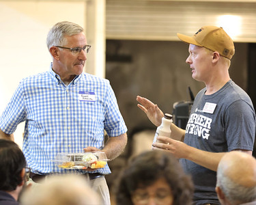 Pennsylvania agricultural secretary Russell Redding (left) talks with farmer William Thiele and and other attendees to Friday's Butler County Farm Bureau Legislative Farm Tour at CNC Malt's grain malting facility in the old Clearfield Township Elementary School. Seb Foltz/Butler Eagle 08/20/21